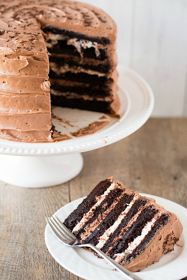 six layer chocolate cake with toasted marshmallow filling and chocolate frosting